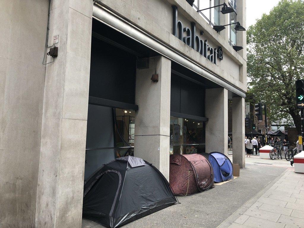 Three homeless men pitch tents outside Habitat furniture shop in Tottenham Court