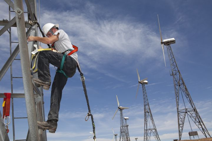 Cullen Curarelli, a laid-off Ohio plumber enrolled in a wind turbine technician class at Cerro Coso Community College, perfor