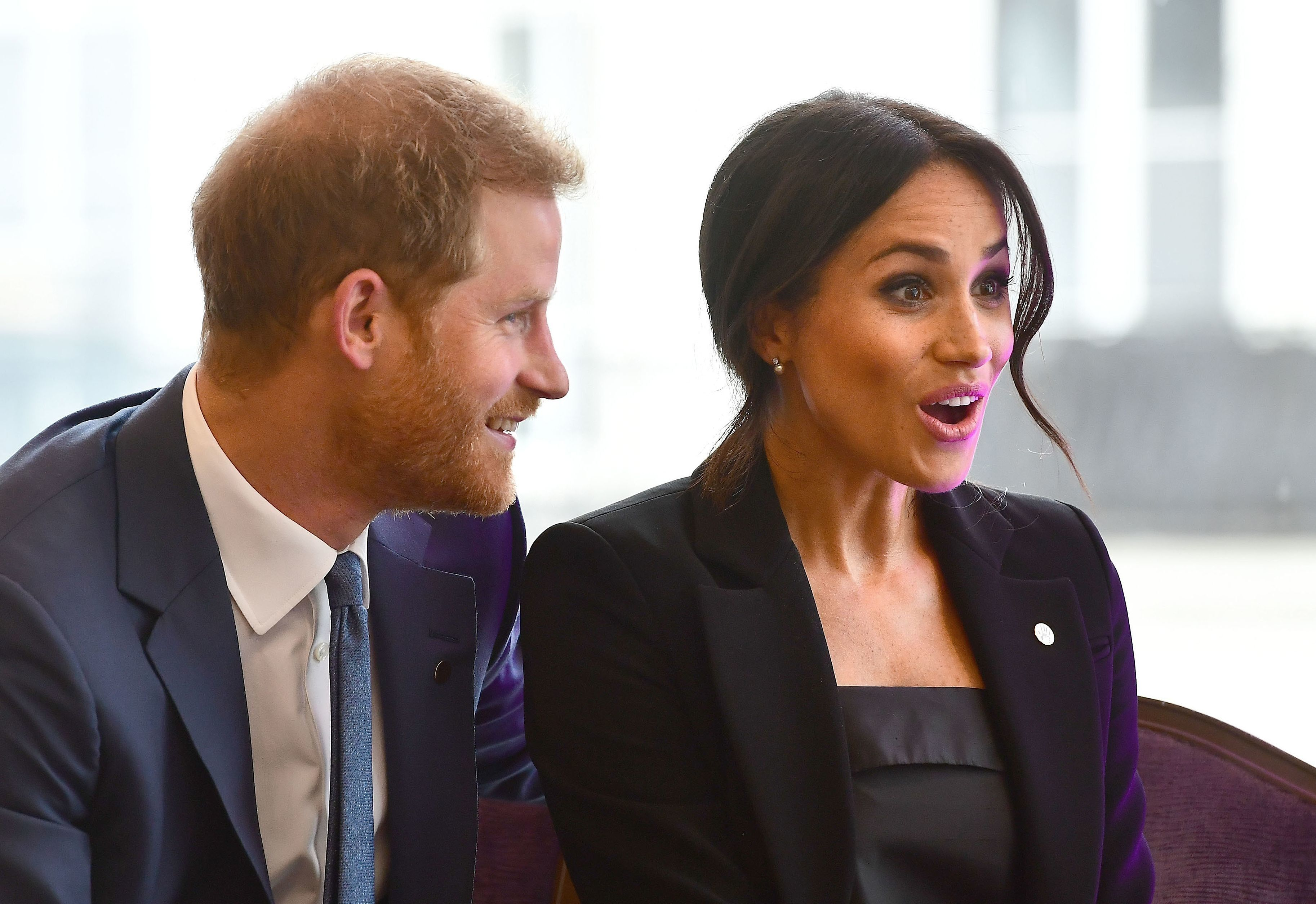 Britain's Prince Harry, Duke of Sussex, and his wife Meghan, Duchess of Sussex attend the WellChild Awards in London on September 4, 2018. - The awards recognise the courage of seriously ill children, their families and carers. (Photo by Victoria Jones / POOL / AFP)        (Photo credit should read VICTORIA JONES/AFP/Getty Images)
