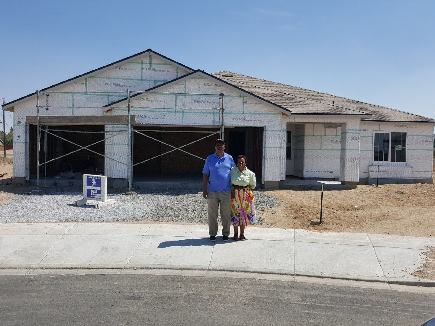 Marion and Lloid Heim stand in front of their new house in Reno, mid-construction -- Aug. 2018<i></i>