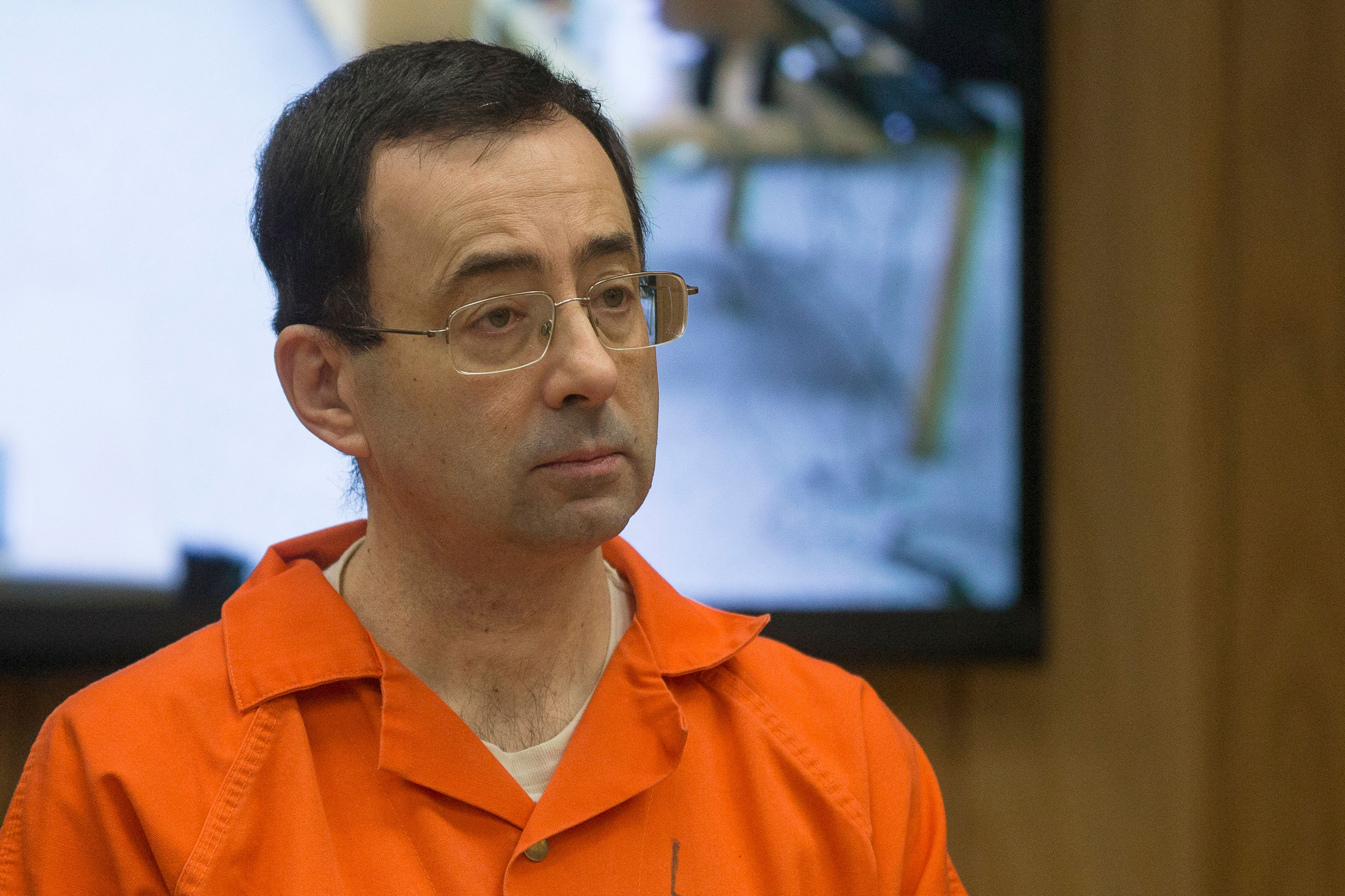 Former Michigan State University and USA Gymnastics doctor Larry Nassar appears in court for his final sentencing phase in Eaton County Circuit Court on February 5, 2018 in Charlotte, Michigan. / AFP PHOTO / RENA LAVERTY        (Photo credit should read RENA LAVERTY/AFP/Getty Images)