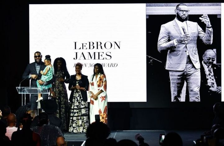 LeBron James accepts the Icon360 award from Harlem's Fashion Row on Tuesday night.
