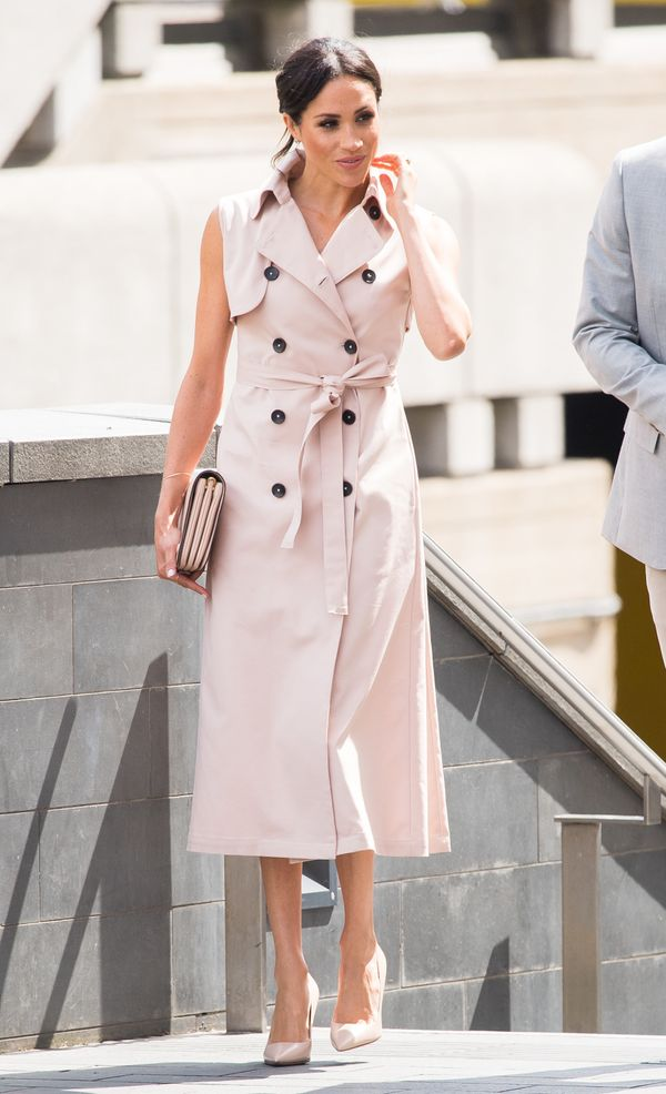 """This <a href=""""https://www.houseofnonie.com/"""" target=""""_blank"""">Nonie trench coat dress</a>, which Markle wore to visit the Nels"""