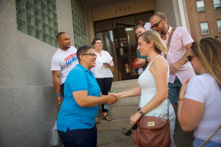 Democratic primary candidate Kerri Evelyn Harris, a gay Air Force veteran, greets a supporter in Wilmington, Delaware, on Jul