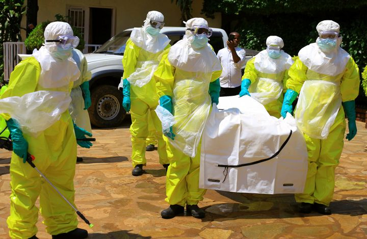 Congolese officials and World Health Organization officials wear protective suits as they participate in Ebola outbreak train