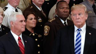 U.S. President Donald Trump, right, and U.S. Vice President Mike Pence, left, attend a meeting with sheriffs from across the country at the White House in Washington, D.C., U.S., on Wednesday, Sept. 5, 2018. During the meeting Trump challenged the anonymous op-ed, claiming organized opposition from within his administration, published Wednesday in the New York Times. Photographer: Yuri Gripas/Bloomberg via Getty Images