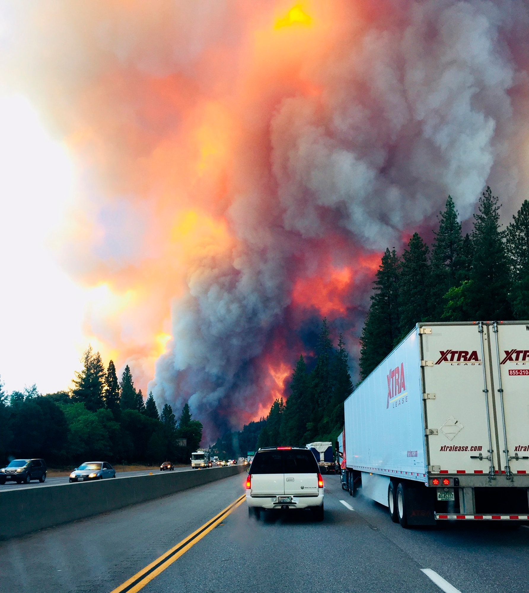 A fire rages as motorists travel on Interstate 5 near Lake Shasta Calif Wednesday Sept 5 2018