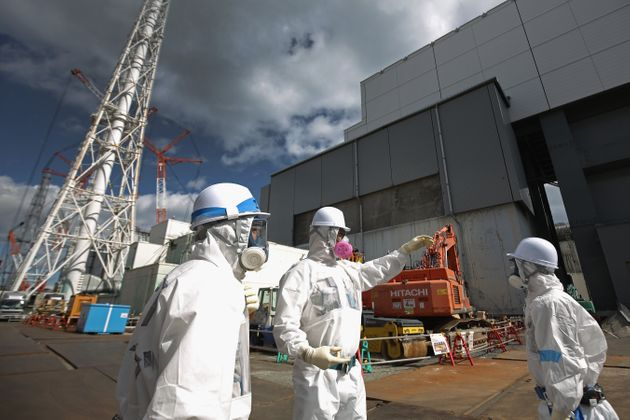 Workers seen at the Fukushima nuclear power plant in