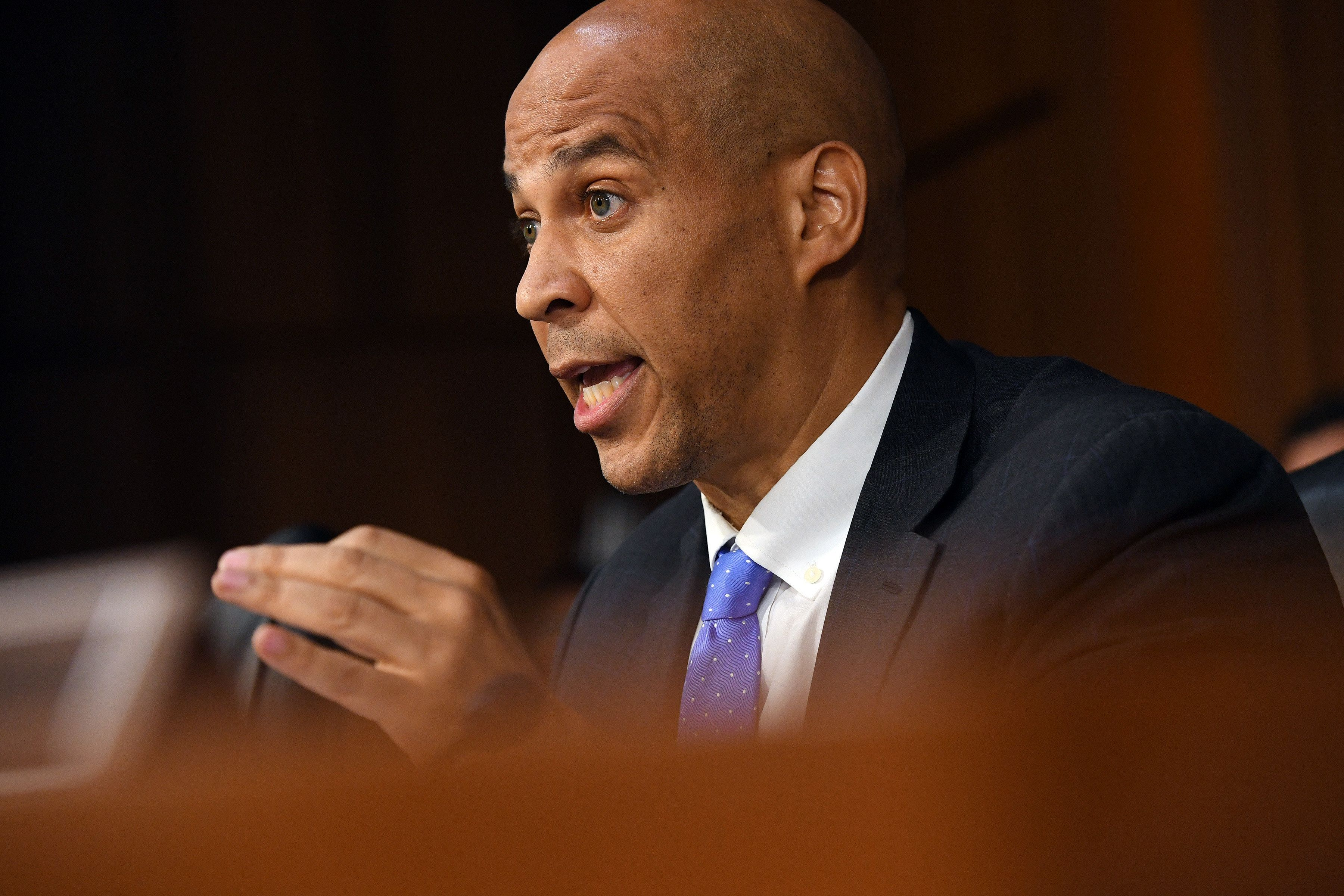 Sen. Cory Booker (D-N.J.) asks Supreme Court nominee Brett Kavanaugh a question during a confirmation hearing on Wednesday.