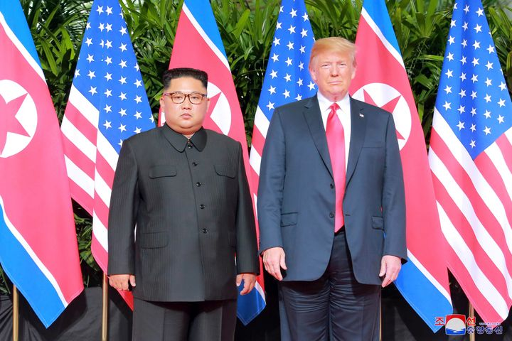 President Donald Trump and North Korean leader Kim Jong Un pose at the Capella Hotel on Sentosa island in Singapore in this p