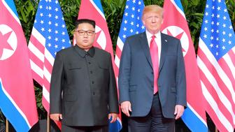 U.S. President Donald Trump and North Korean leader Kim Jong Un pose at the Capella Hotel on Sentosa island in Singapore in this picture released on June 12, 2018 by North Korea's Korean Central News Agency. KCNA via REUTERS ATTENTION EDITORS - THIS PICTURE WAS PROVIDED BY A THIRD PARTY. REUTERS IS UNABLE TO INDEPENDENTLY VERIFY THE AUTHENTICITY, CONTENT, LOCATION OR DATE OF THIS IMAGE. NO THIRD PARTY SALES. NOT FOR USE BY REUTERS THIRD PARTY DISTRIBUTORS. SOUTH KOREA OUT. NO COMMERCIAL OR EDITORIAL SALES IN SOUTH KOREA.