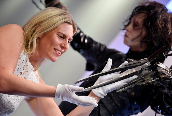 "An employee with a costume worn by Johnny Depp in the 1990 film ""Edward Scissorhands."""