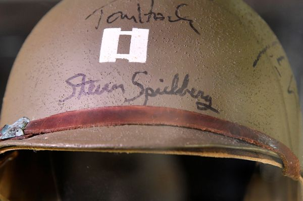 A detail of Capt. Miller's helmet, worn by Tom Hanks and signed by him and director Steven Spielberg, from 1998's