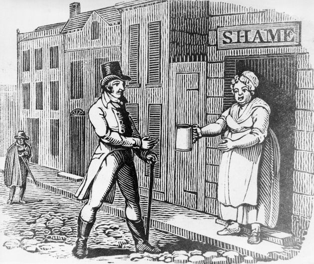 Circa 1810: A woman proffers a jug of ale to a man in the street from her