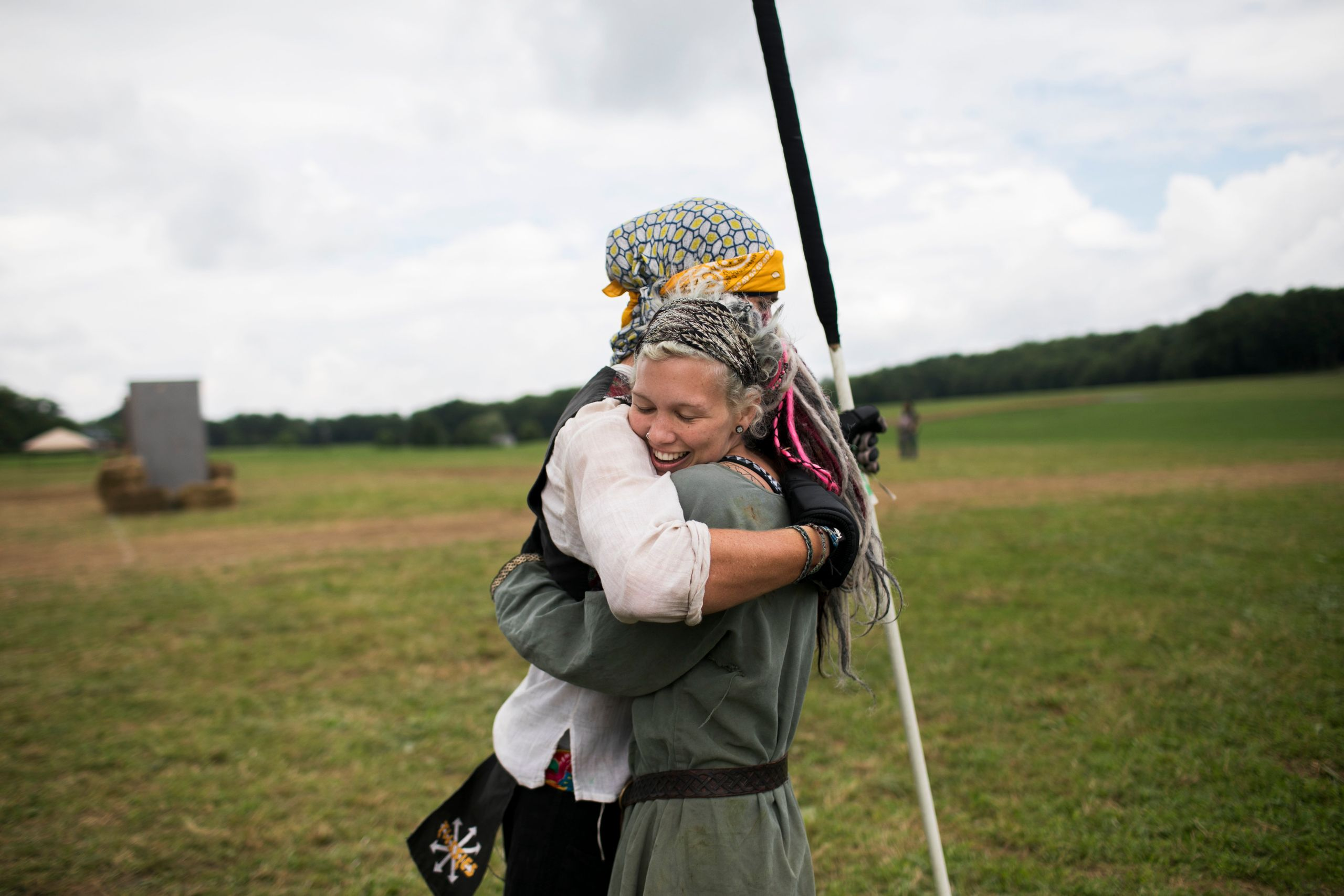 Attendees hug on the field while training for battle.