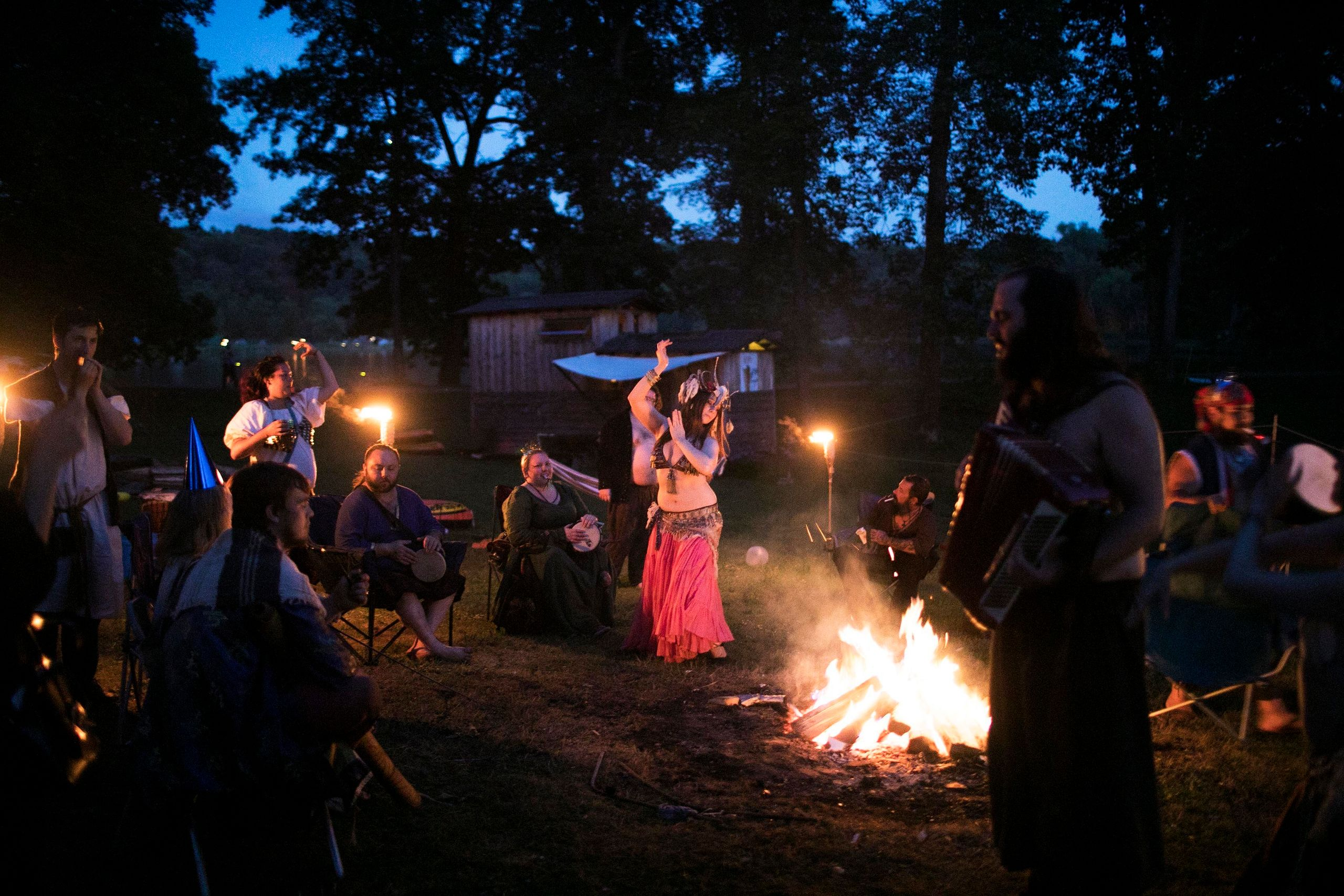 Rag attendees drink, dance and make merriment around the fire at an after-hours campout.