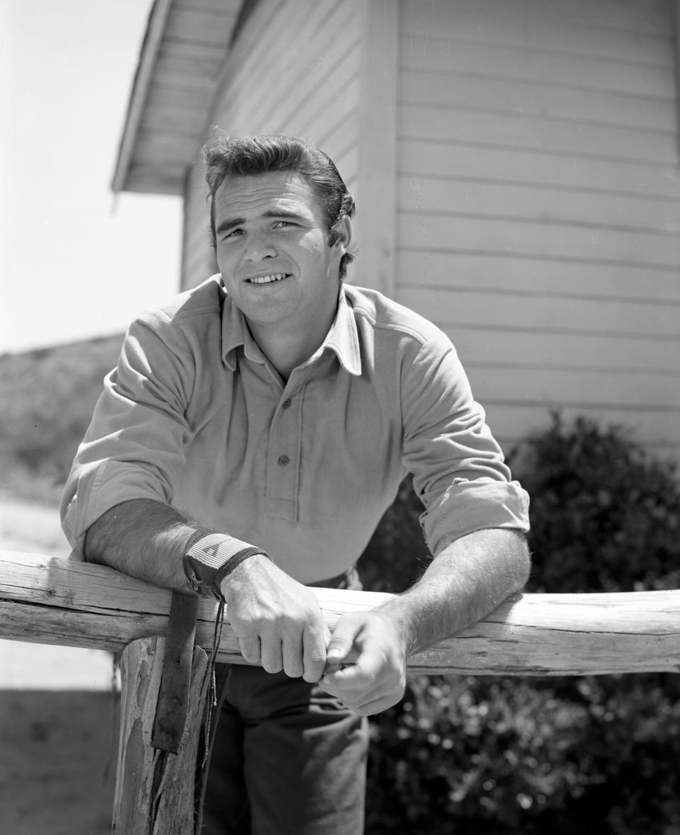 Burt Reynolds (as Quint Asper, a blacksmith) poses for character photographers for the CBS Television western Gunsmoke. Image