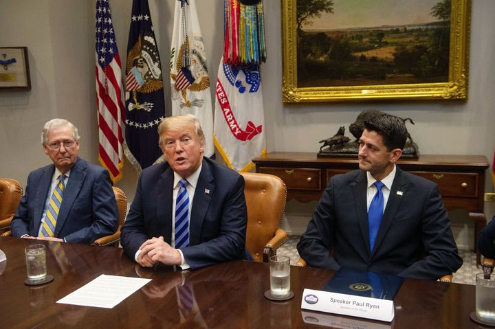 President Donald Trump speaks to the press with Senate Majority Leader Mitch McConnell (left) and House Speaker Paul Ryan (ri