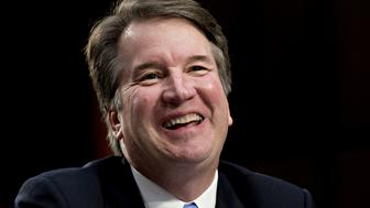 Brett Kavanaugh, U.S. Supreme Court associate justice nominee for U.S. President Donald Trump, laughs during a Senate Judiciary Committee confirmation hearing in Washington, D.C., U.S., on Thursday, Sept. 6, 2018. Kavanaugh yesterday steered clear of trouble in a marathon day before a Senate panel, refusing to say whether he would overturn the constitutional right to abortion or disqualify himself from any case directly involving Trump. Photographer: Andrew Harrer/Bloomberg via Getty Images