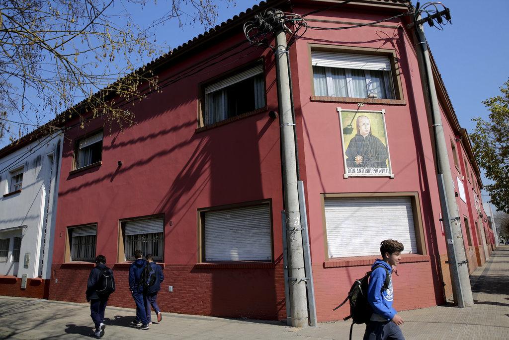 Children walk past the Antonio Provolo Institute in La Plata, Argentina, Thursday Sept 6, 2018.