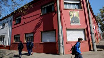 Children walk past the Antonio Provolo Institute in La Plata Argentina Thursday Sept 6 2018 Authorities in Argentina carried out raids Thursday at a Catholic-run school for youths with hearing disabilities as part of an investigation into alleged sexual abuse of vulnerable children that has shocked the Pope Franciss homeland