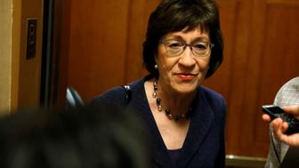Senator Susan Collins (R-ME) speaks to reporters as she arrives for a nomination vote at the U.S. Capitol in Washington, U.S., December 19, 2017.   REUTERS/Joshua Roberts