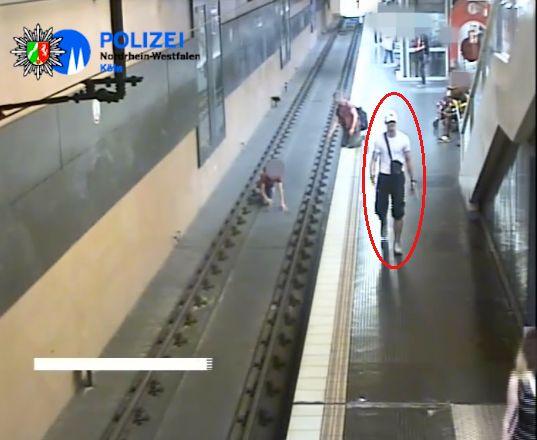 Polizei sucht Gewalttäter: Video zeigt, wie Passant brutal ins Gleis geschubst