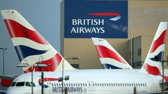 British Airways aircraft are seen at Heathrow Airport in west London, Britain, February 23, 2018. REUTERS/Hannah McKay