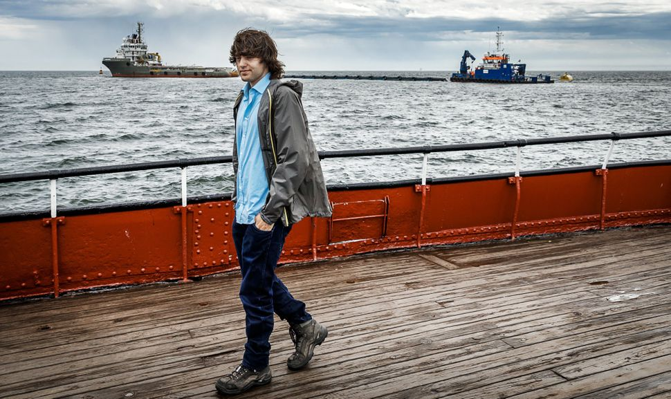 Boyan Slat in front of a prototype of the Ocean Cleanup off the Netherlands in June 2016.
