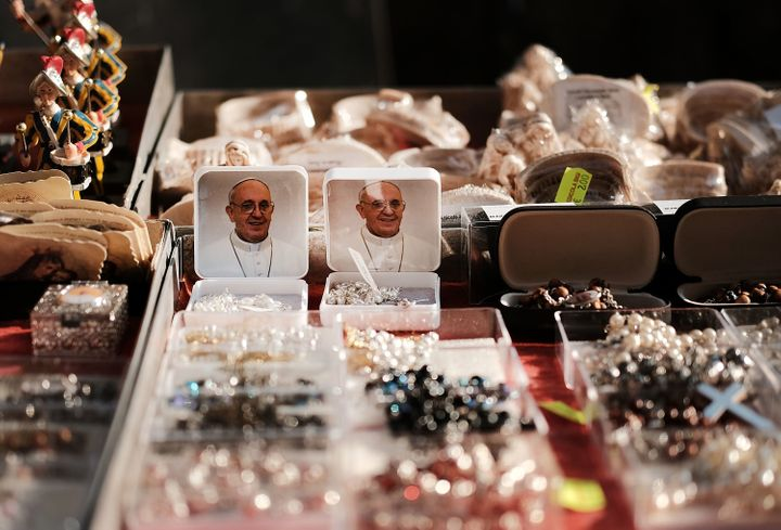 A vendor sells Pope Francis magnets and other items outside of St. Peter's Basilica on August 31, 2018 in Vatican City, Vatic