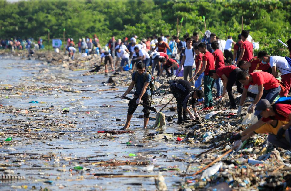 Volunteers collect garbage along the coast in Manila, the Philippines, during the annual International...