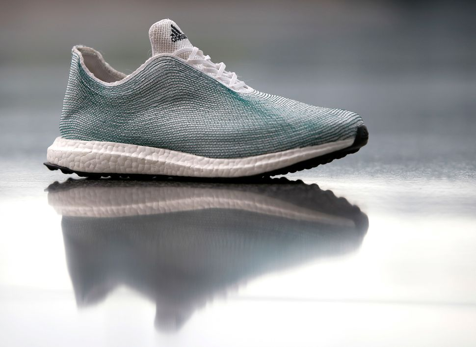 An Adidas shoe made from recycled ocean plastic.
