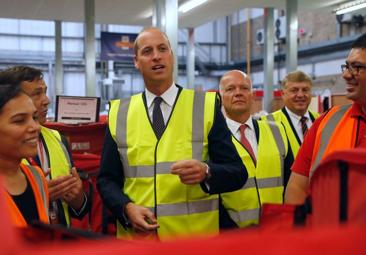 Prince William talks to Royal Mail sorting office workers during a visit to the Royal Mail International Distribution Centre on Sept. 6 in Slough, England.
