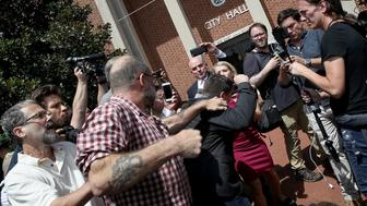 CHARLOTTESVILLE, VA - AUGUST 13:  A counter protester tries to punch Jason Kessler, an organizer of 'Unite the Right' rally, after Kessler tried to speak outside the Charlottesville City Hall on August 13, 2017 in Charlottesville, Virginia. The city of Charlottesville remains on edge following violence at a 'Unite the Right' rally held by white nationalists, neo-Nazis and members of the 'alt-right'  (Photo by Win McNamee/Getty Images)