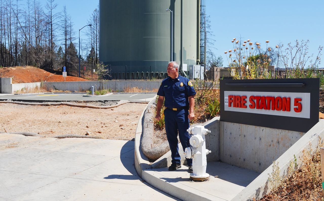 """A Santa Rosa fire station was among the many buildings destroyed during the Northern California """"firestorm"""" last October. Santa Rosa Fire Chief Tony Gossner is pictured here in front of the empty lot."""