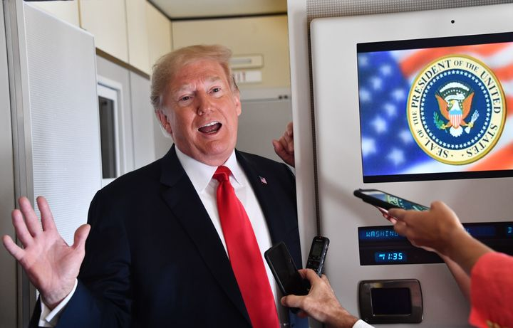 President Donald Trump speaks to the press aboard Air Force One on Sept. 7, 2018, as he travels to Fargo, North Dakota.