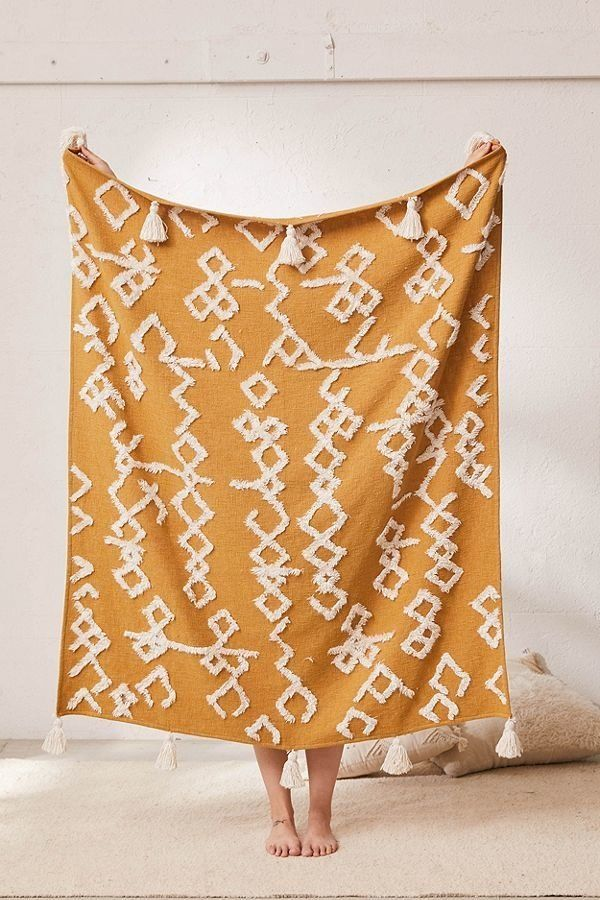 """Get it <a href=""""https://www.urbanoutfitters.com/shop/geo-tufted-tassel-throw-blanket?category=on-campus&color=025&qua"""