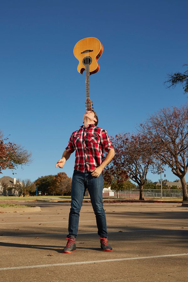 Josh Horton balanced a guitar on his noggin for 7 minutes, 3.9 seconds.