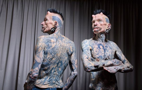 Rolf Bucholz has 516 piercings and implants on his body.