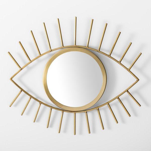 "Get it <a href=""https://www.target.com/p/eye-decorative-mirror-wall-sculpture-gold-room-essentials-153/-/A-53158902"" target="""