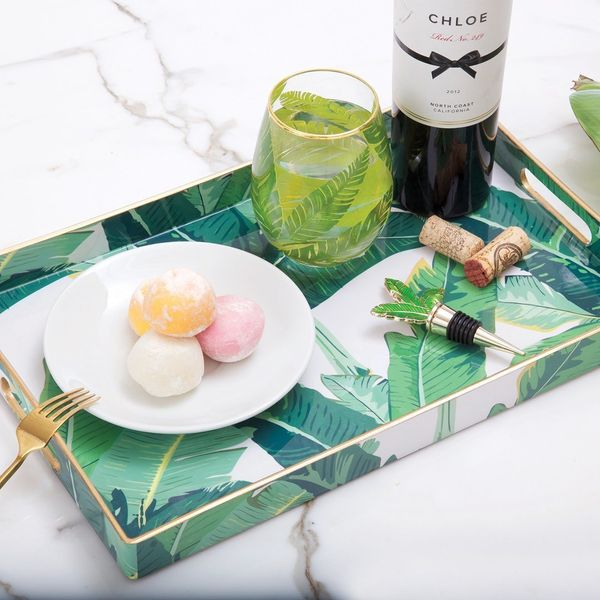"""Get it <a href=""""https://www.dormify.com/products/rectangle-banana-leaf-tray"""" target=""""_blank"""">here</a>."""