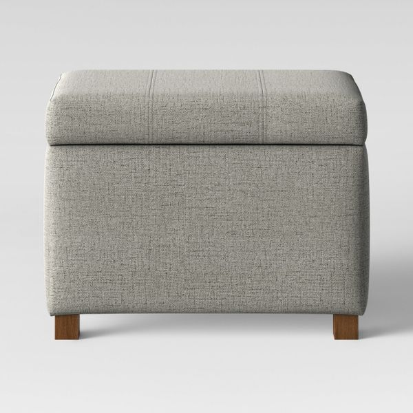 """Get it <a href=""""https://www.target.com/p/essex-storage-ottoman-gray-threshold-153/-/A-53164934"""" target=""""_blank"""">here</a>.&nbs"""