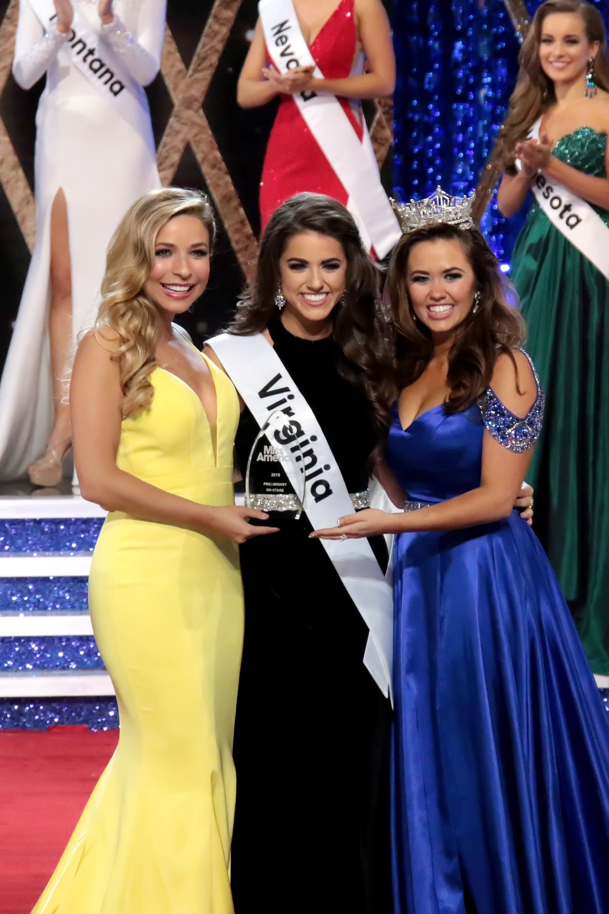 ATLANTIC CITY, NJ - SEPTEMBER 06:  Kira Kazantsev, Miss America 2015, Miss Virginia, Emili McPhail winner of On Stage Question and Cara Mund 2018 the 2nd Night of Preliminaries of the Miss America 2.0 competition at Atlantic City Boardwalk Hall on September 6, 2018 in Atlantic City, New Jersey.  (Photo by Donald Kravitz/Getty Images)