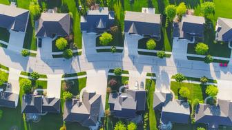Idyllic neighborhood street, aerial view.