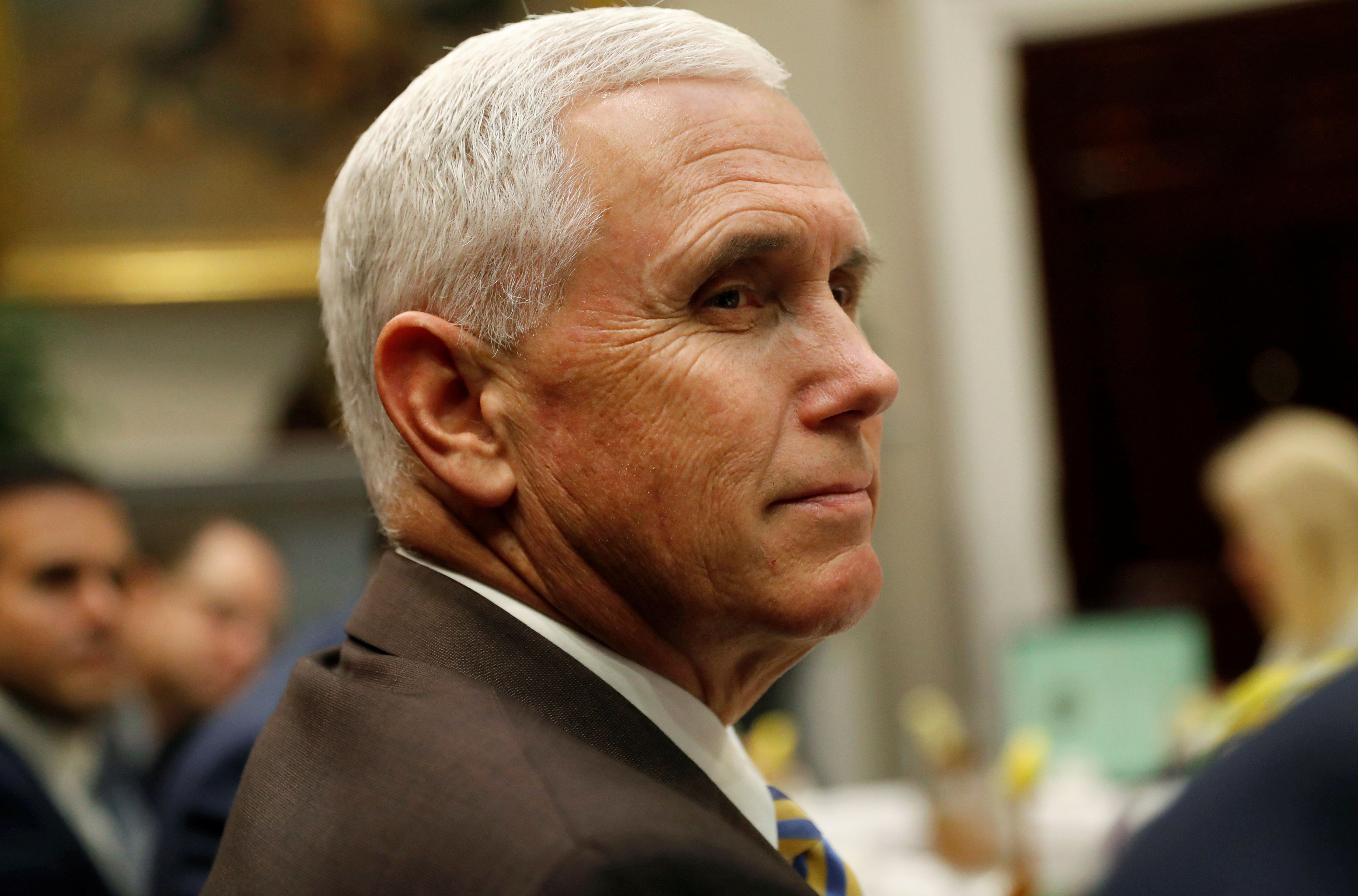 ?Vice President Mike Pence? listens during a working lunch with governors and U.S. President Donald Trump in the Roosevelt Room at the White House in Washington, U.S., June 21, 2018. REUTERS/Leah Millis