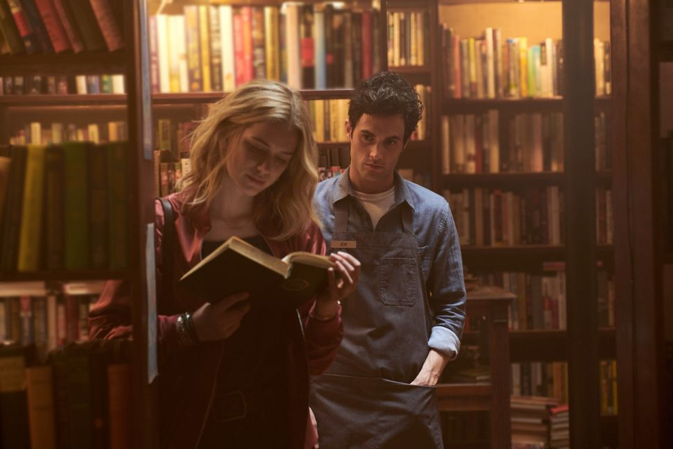 "Elizabeth Lail and Penn Badgley in the pilot episode of ""You."""