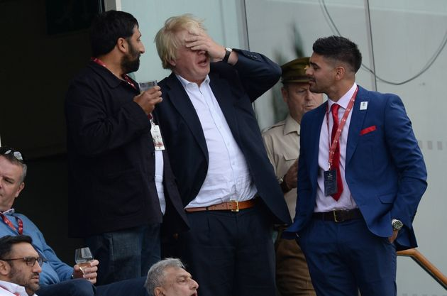The politician was immediately spotted by commentators as he stood with friends in the stands on