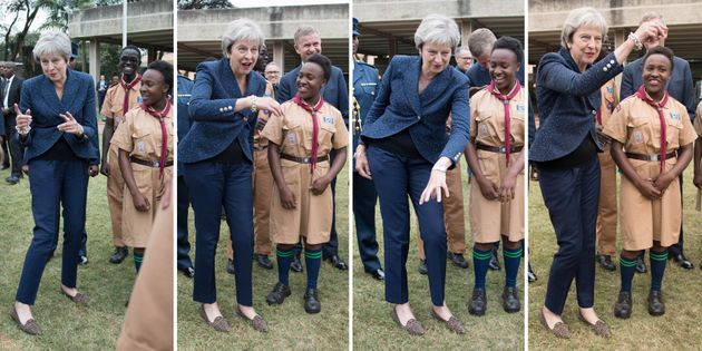 A composite picture of Prime Minister Theresa May breaking into dance whilst meeting with scouts at the United Nations offices in Nairobi on the third day of her visit to Africa.