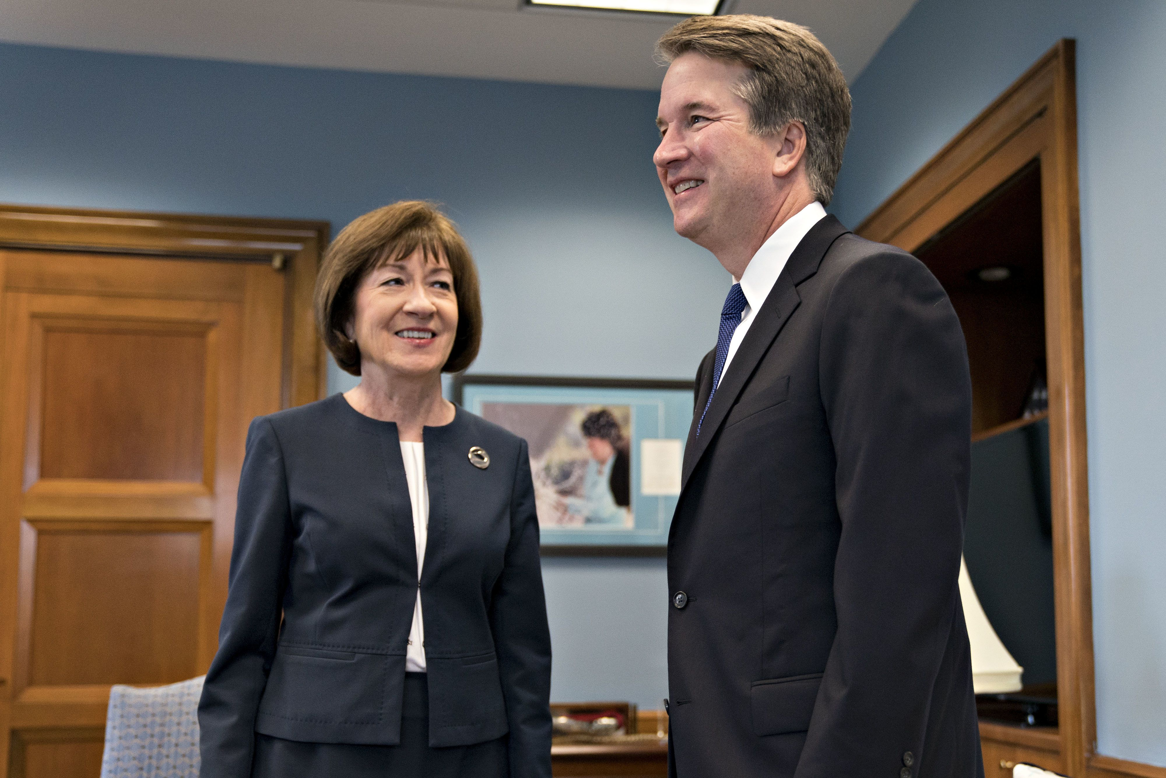 Brett Kavanaugh, U.S. Supreme Court associate justice nominee for U.S. President Donald Trump, right, and Senator Susan Collins, a Republican from Maine, smile during a meeting on Capitol Hill in Washington, D.C., U.S., on Tuesday, Aug. 21, 2018. Collins plans to ask Kavanaugh about abortion and said she intended to talk about his praise for the then-Justice William Rehnquist's dissent in Roe v. Wade, the landmark 1973 abortion-rights case. Photographer: Andrew Harrer/Bloomberg via Getty Images
