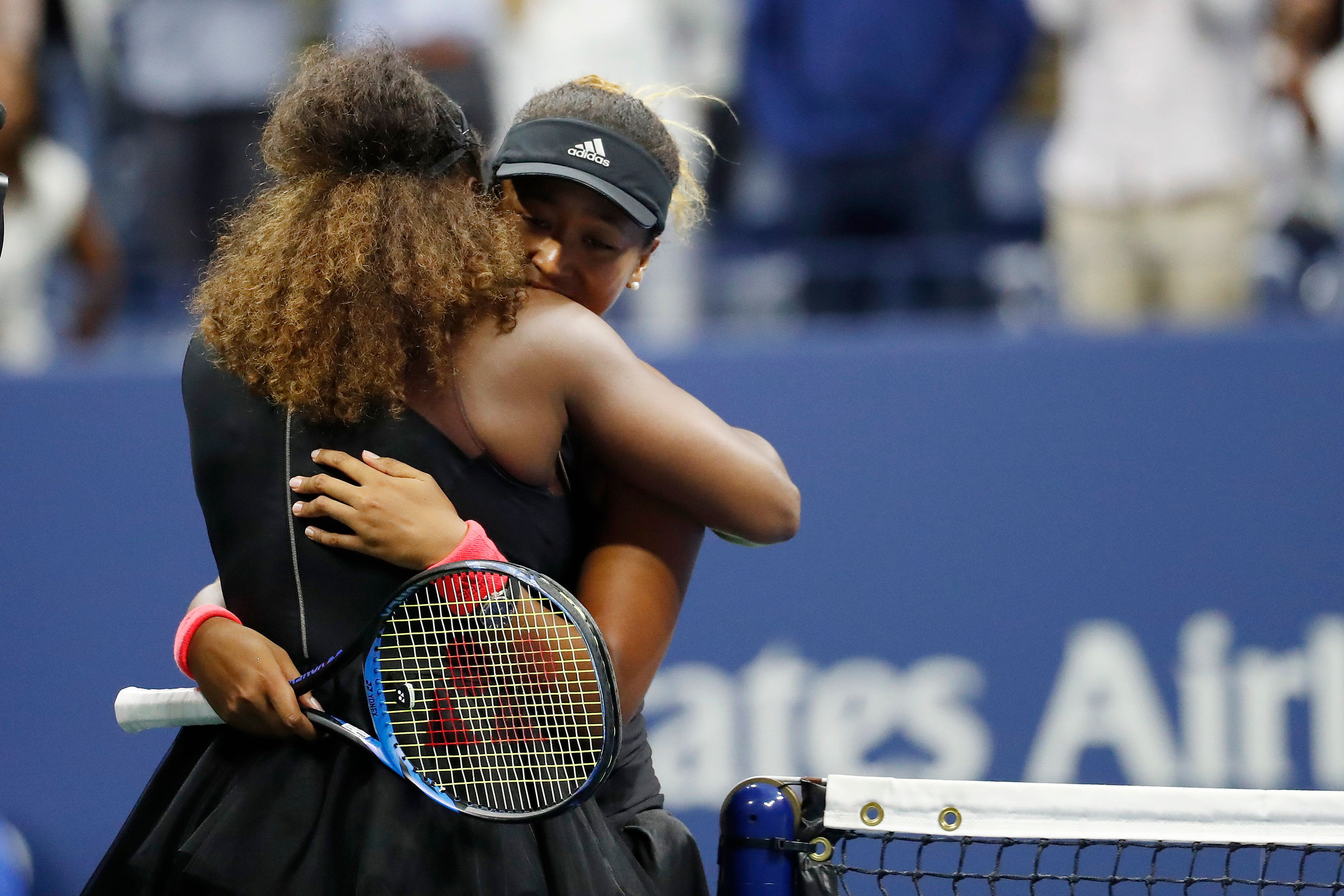 Sep 8, 2018; New York, NY, USA; Naomi Osaka of Japan (R) hugs Serena Williams of the United States (L) after their match in the women's final on day thirteen of the 2018 U.S. Open tennis tournament at USTA Billie Jean King National Tennis Center. Mandatory Credit: Geoff Burke-USA TODAY Sports